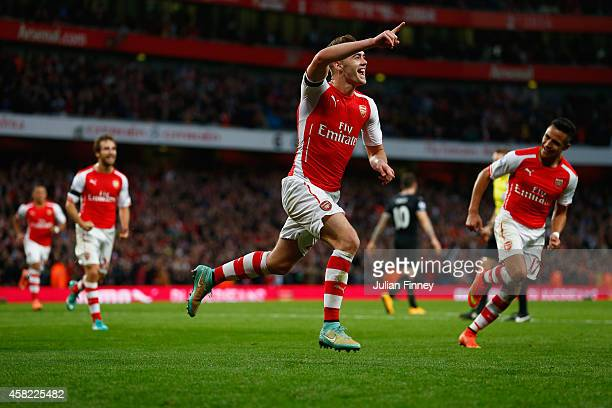 Calum Chambers of Arsenal celebrates scoring the second goal for Arsenal during the Barclays Premier League match between Arsenal and Burnley at...