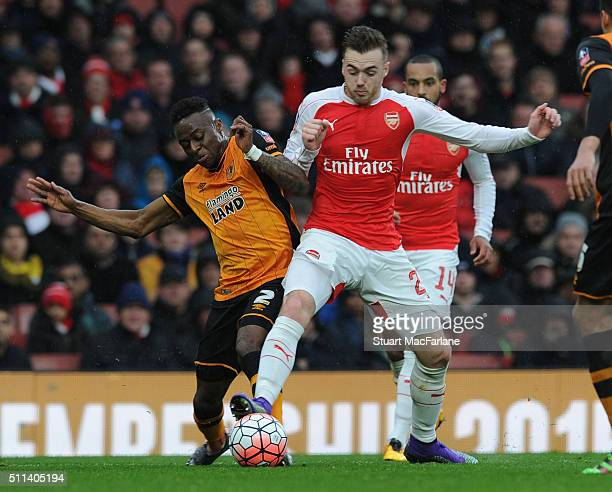 Calum Chambers of Arsenal challenged by Moses Odubajo of Hull during the Emirates FA Cup Fifth Round match between Arsenal and Hull City at Emirates...