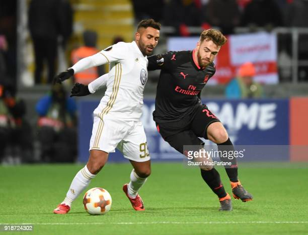 Calum Chambers of Arsenal challenges Saman Ghoddos of Ostersunds during UEFA Europa League Round of 32 match between Ostersunds FK and Arsenal at the...
