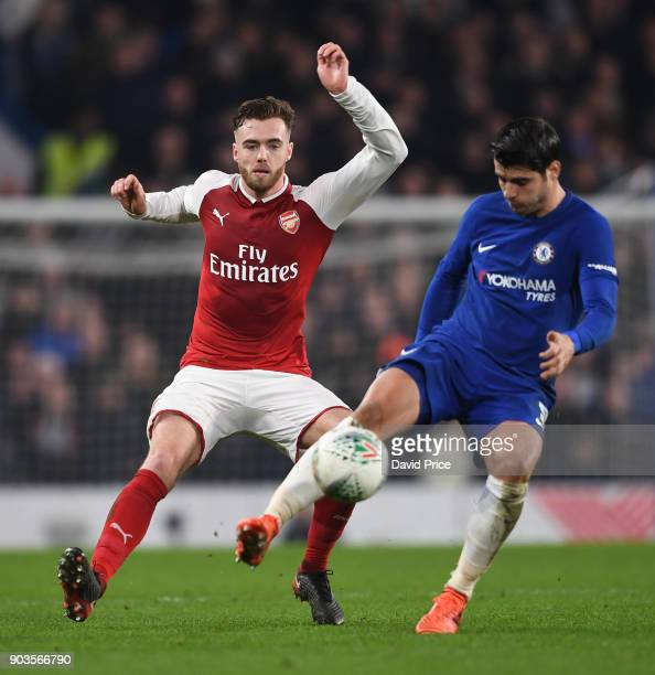 Calum Chambers of Arsenal closes down Alvaro Morata of Chelsea during the Carabao Cup Semie Final 1st leg match between Chelsea and Arsenal at...