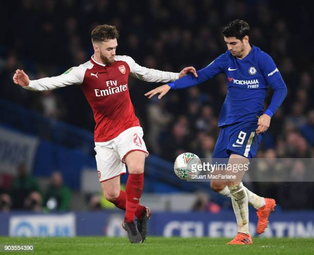 Calum Chambers of Arsenal holds off Alvaro Morata of Chelsea during the Carabao Cup SemiFinal First Leg match between Chelsea and Arsenal at Stamford...