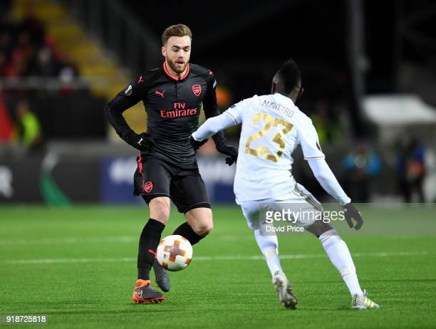 Calum Chambers of Arsenal knocks the ball past Samuel Mensah of Ostersunds during UEFA Europa League Round of 32 match between Ostersunds FK and...