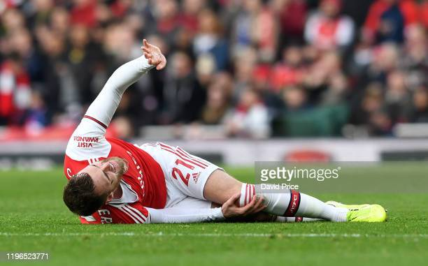 Calum Chambers of Arsenal on the floor injured during the Premier League match between Arsenal FC and Chelsea FC at Emirates Stadium on December 29,...