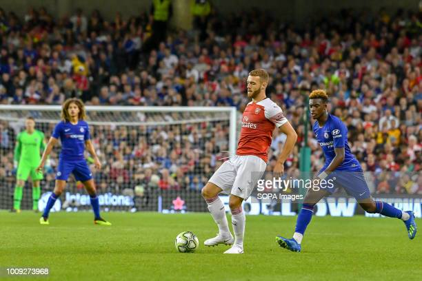 Calum Chambers of Arsenal plays away from Callum HudsonOdoi of Chelsea during the Chelsea v Arsenal International Champions Cup in Aviva Stadium