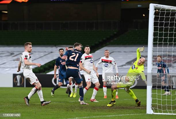 Calum Chambers of Arsenal scores a goal that was later disallowed during the UEFA Europa League Group B stage match between Dundalk FC and Arsenal FC...