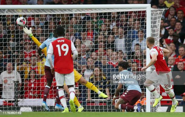 Calum Chambers of Arsenal scores his team's second goal during the Premier League match between Arsenal FC and Aston Villa at Emirates Stadium on...
