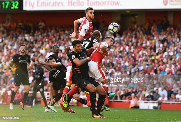 Calum Chambers of Arsenal scores his team's third goal during the Premier League match between Arsenal and Liverpool at Emirates Stadium on August 14...