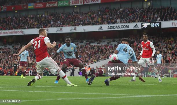 Calum Chambers of Arsenal scores the second equalising goal during the Premier League match between Arsenal FC and Aston Villa at Emirates Stadium on...