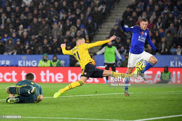 Calum Chambers of Arsenal stretches for the ball as Jamie Vardy of Leicester City attempts to shoot during the Premier League match between Leicester...