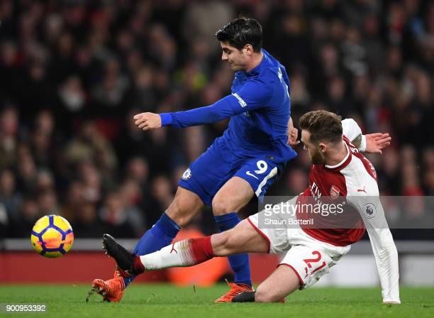 Calum Chambers of Arsenal tackles Alvaro Morataof Chelsea during the Premier League match between Arsenal and Chelsea at Emirates Stadium on January...