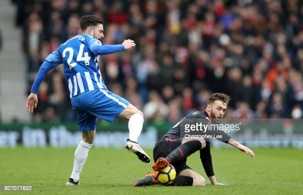 Calum Chambers of Arsenal tackles Davy Propper of Brighton and Hove Albion during the Premier League match between Brighton and Hove Albion and...