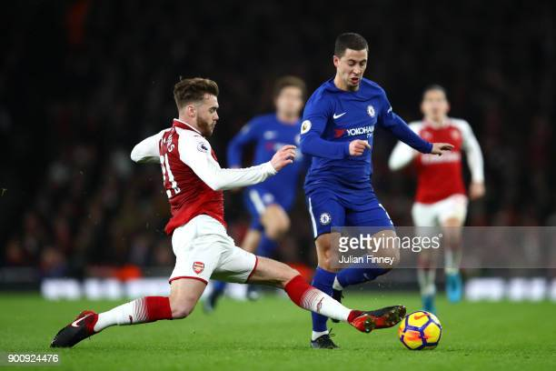 Calum Chambers of Arsenal tackles Eden Hazard of Chelsea during the Premier League match between Arsenal and Chelsea at Emirates Stadium on January 3...