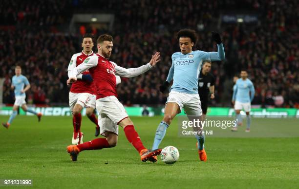 Calum Chambers of Arsenal tackles Leroy Sane of Manchester City during the Carabao Cup Final between Arsenal and Manchester City at Wembley Stadium...