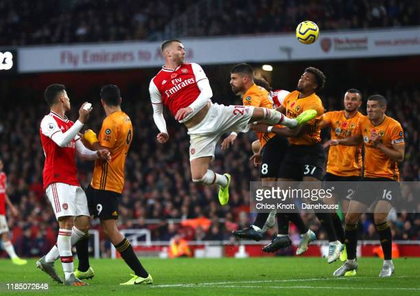 Calum Chambers of Arsenal takes a shot at the goal during the Premier League match between Arsenal FC and Wolverhampton Wanderers at Emirates Stadium...