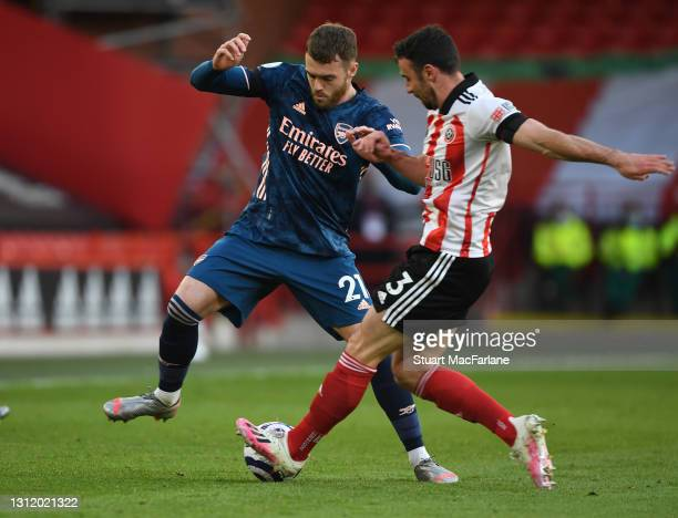 Calum Chambers of Arsenal takes on Enda Stevens of Sheffield United during the Premier League match between Sheffield United and Arsenal at Bramall...