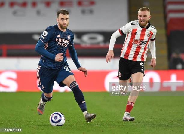 Calum Chambers of Arsenal takes on Oliver McBurnie of Sheffield United during the Premier League match between Sheffield United and Arsenal at...