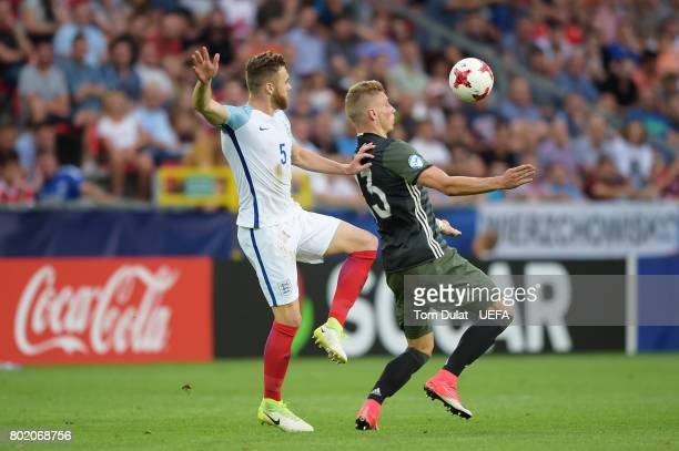 Calum Chambers of England and Felix Platte of Germany battle for possession during the UEFA European Under21 Championship Semi Final match between...