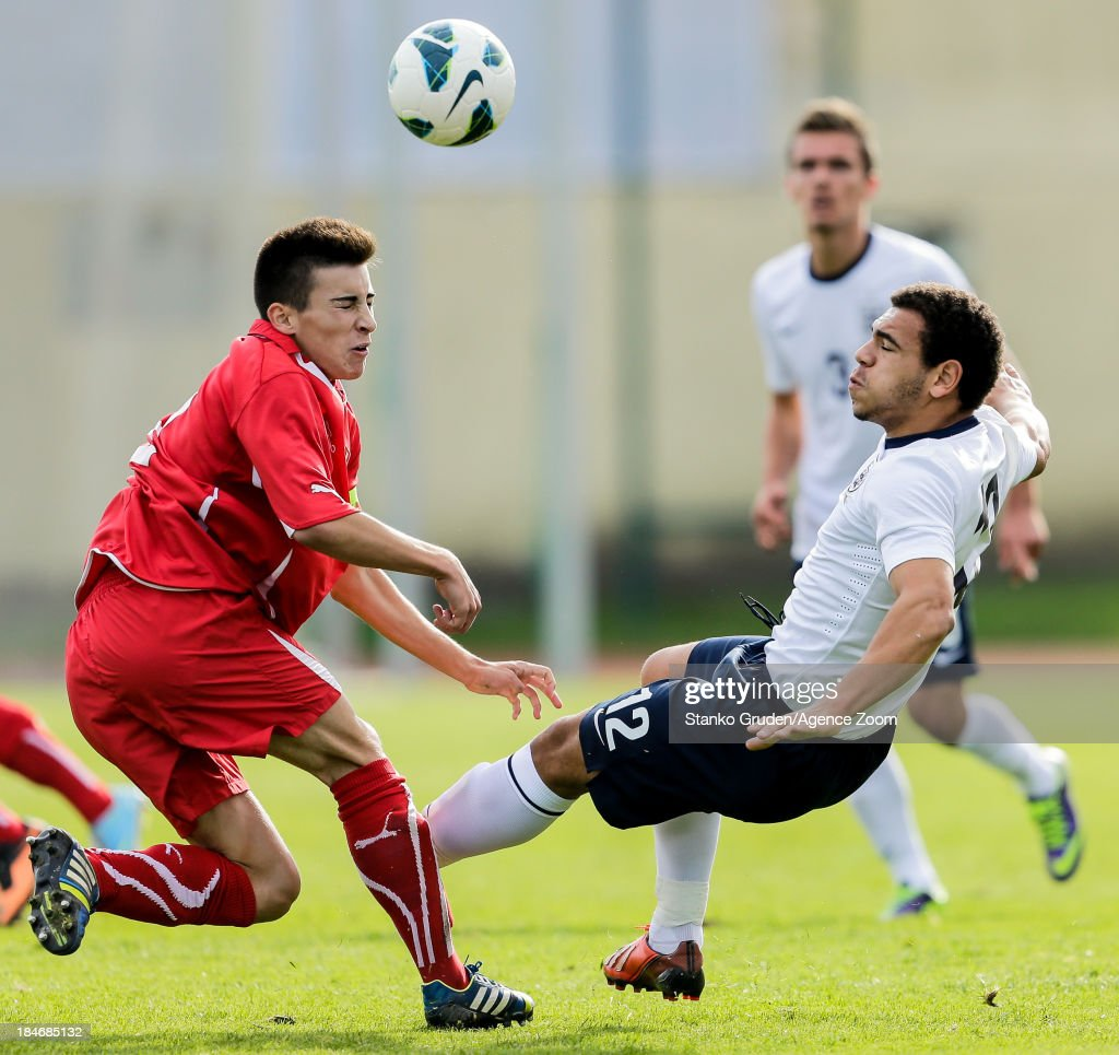 Calum Chambers of England and Pascal Albrecht of Switzerland and during the UEFA U19 Championships Qualifier between England and Switzerland, on October 15, 2013 in Ptuj, Slovenia.