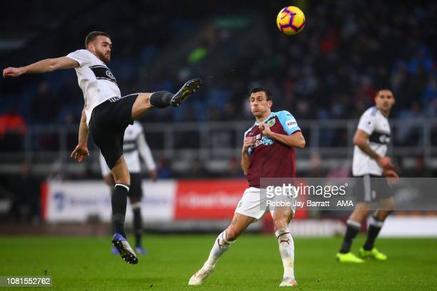 Calum Chambers of Fulham and Jack Cork of Burnley during the Premier League match between Burnley FC and Fulham FC at Turf Moor on January 12 2019 in...