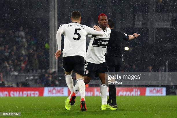 Calum Chambers of Fulham celebrates as he scores his team's first goal with Ryan Babel during the Premier League match between Fulham and Brighton...
