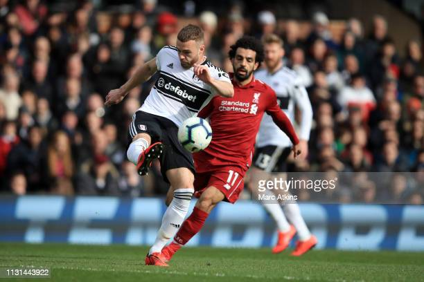 Calum Chambers of Fulham in action with Mohamed Salah of Liverpool during the Premier League match between Fulham FC and Liverpool FC at Craven...