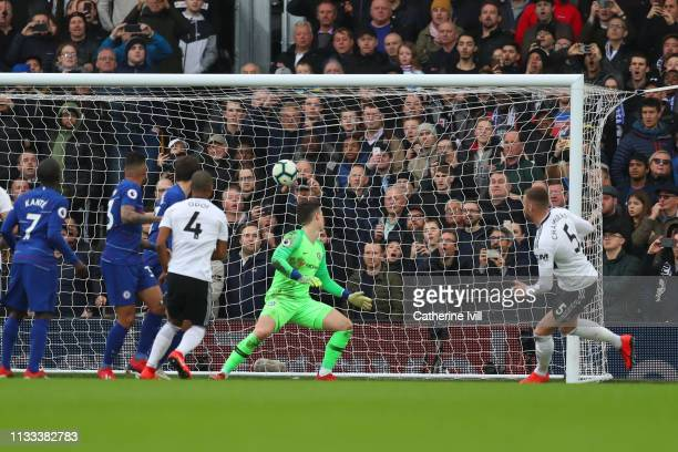 Calum Chambers of Fulham scores his sides first goal during the Premier League match between Fulham FC and Chelsea FC at Craven Cottage on March 03...