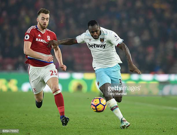 Calum Chambers of Middlesbrough tackles Michail Antonio of West Ham United during the Premier League match between Middlesbrough and West Ham United...