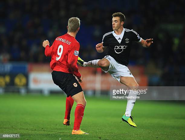 Calum Chambers of Southampton challenges Andreas Cornelius of Cardiff City during the Barclays Premier League match between Cardiff City and...