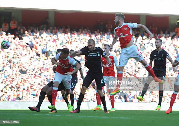 Calum Chambers scores the third Arsenal goal during the Premier League match between Arsenal and Liverpool at Emirates Stadium on August 14, 2016 in...