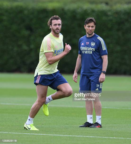 Calum Chambers with Arsenal fitness coach Tim Parham during a training session at London Colney on June 30 2020 in St Albans England