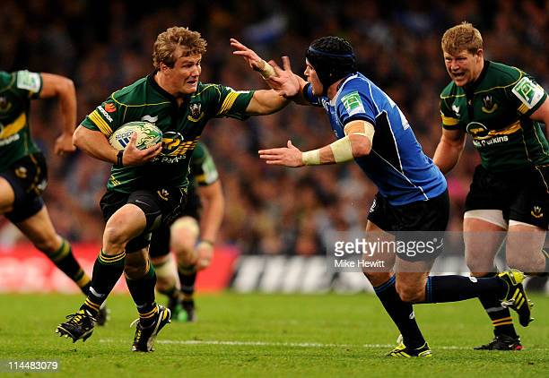 Calum Clark of Northampton is tackled by Shane Jennings of Leinster during the Heineken Cup Final match between Leinster and Northampton Saints at...