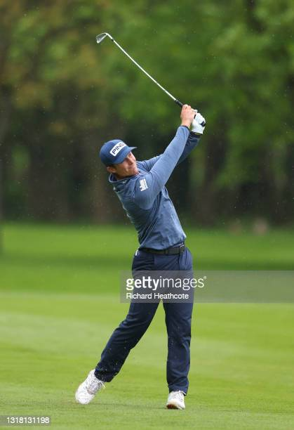 Calum Hill of Scotland plays his second shot on the third hole during the final round of The Betfred British Masters hosted by Danny Willett at The...