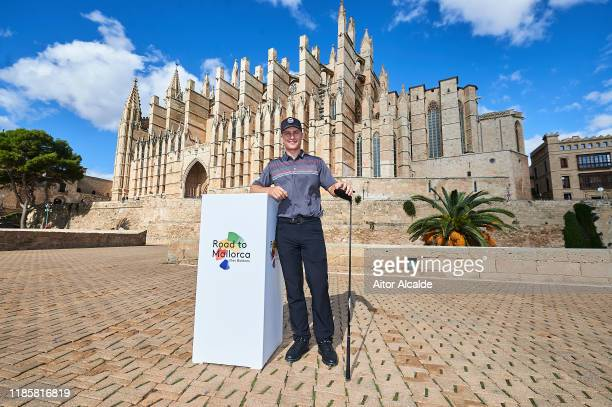 Calum Hill of Scotland poses in front of the Palma de Mallorca Cathedral prior to the Challenge Tour Grand Final at Club de Golf Alcanada on November...