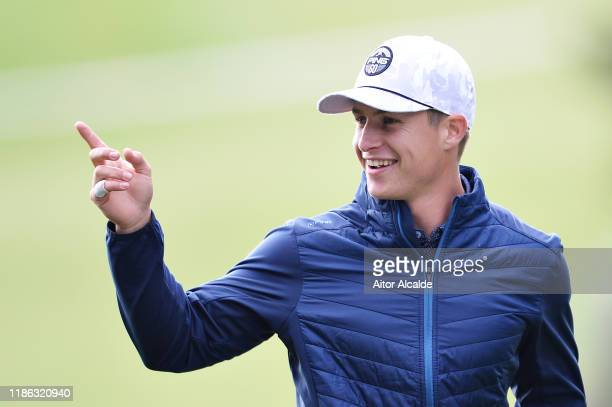 Calum Hill of Scotland reacts to his shot from the second tee during day 2 of the Challenge Tour Grand Final at Club de Golf Alcanada on November 08...