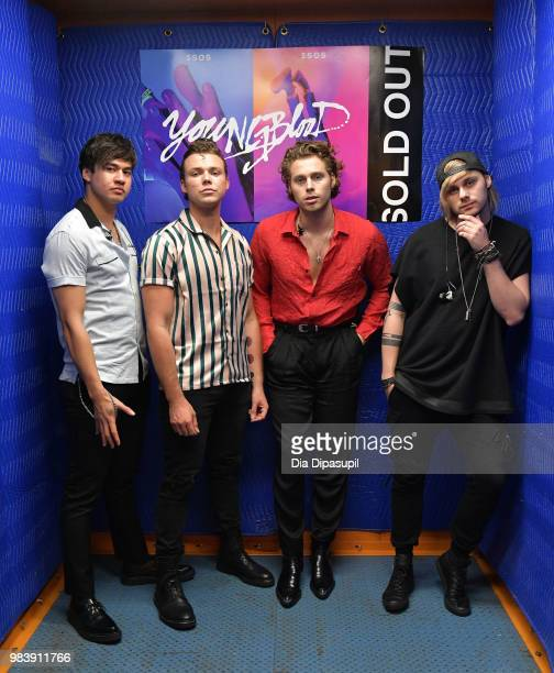 Calum Hood Ashton Irwin Luke Hemmings and Michael Clifford of 5 Seconds of Summer pose backstage before performing at the Tumblr IRL with 5 Seconds...