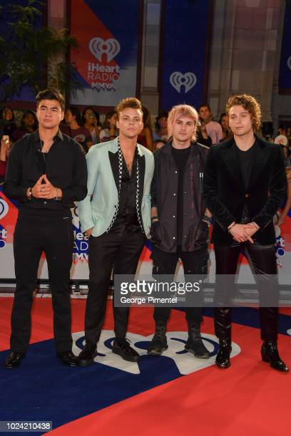 Calum Hood Ashton Irwin Michael Clifford and Luke Hemmings of 5 Seconds of Summer arrive at the 2018 iHeartRADIO MuchMusic Video Awards at MuchMusic...