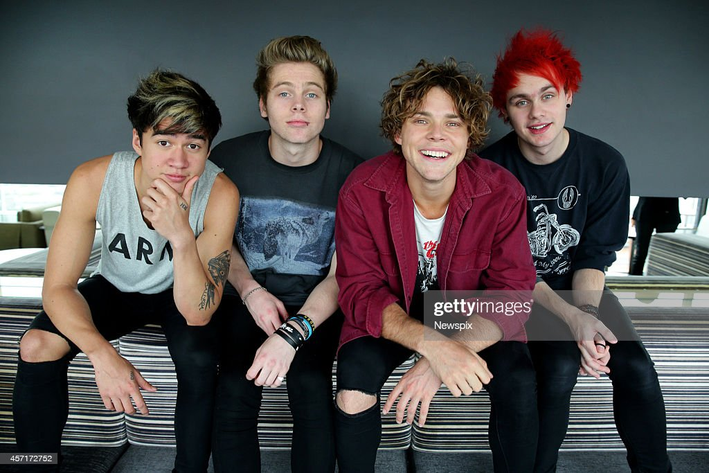 Calum Hood, Luke Hemmings, Aston Irwin and Michael Clifford of Australian boy band '5 Seconds of Summer' (5SOS) pose during a photo shoot at the Intercontinental Hotel on October 12, 2014 in Sydney, Australia.