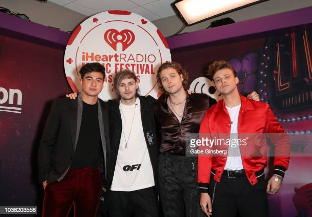Calum Hood Michael Clifford Luke Hemmings and Ashton Irwin of 5 Seconds of Summer attend the 2018 iHeartRadio Music Festival at TMobile Arena on...