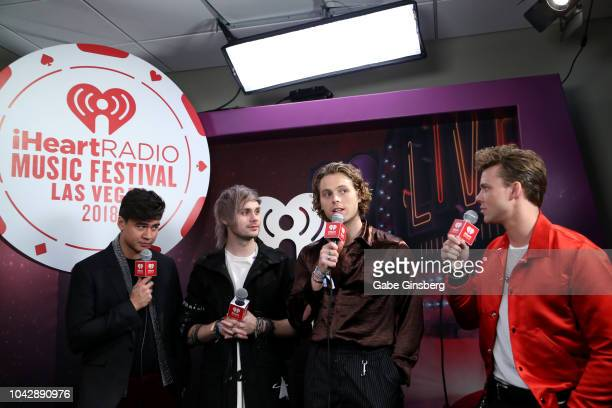 Calum Hood Michael Clifford Luke Hemmings and Ashton Irwin of 5 Seconds of Summer at the iHeartRadio Music Festival at TMobile Arena on September 22...