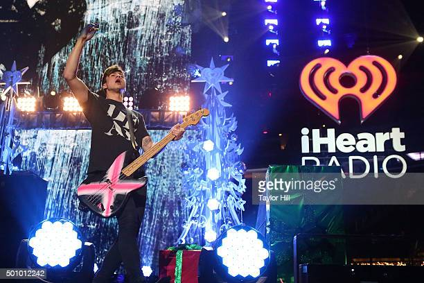 Calum Hood of 5 Seconds of Summer performs during the 2015 Z100 Jingle Ball at Madison Square Garden on December 11 2015 in New York City