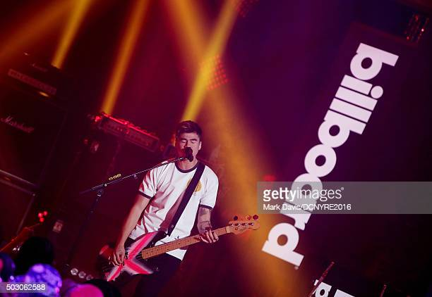 Calum Hood of 5 Seconds Of Summer performs onstage at Dick Clark's New Year's Rockin' Eve with Ryan Seacrest 2016 on December 31 2015 in Los Angeles...
