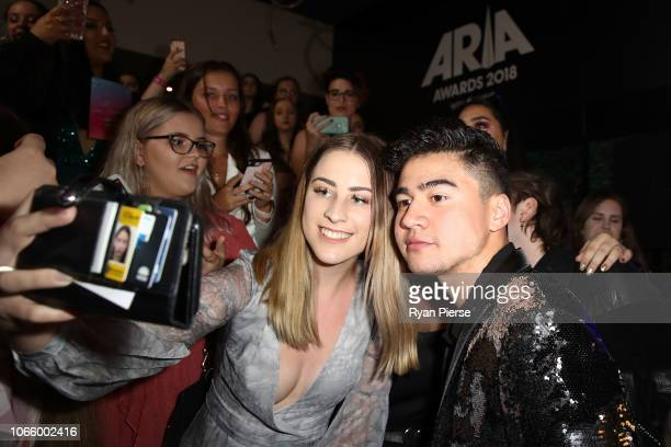 Calum Hood of 5 Seconds of Summer poses with fans ahead of the 32nd Annual ARIA Awards 2018 at The Star on November 28 2018 in Sydney Australia
