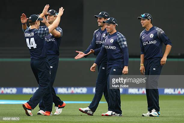 Calum MacLeod of Scotland celebrates with his team mates after taking the catch to dismiss Mahela Jayawardene of Sri Lanka during the 2015 Cricket...