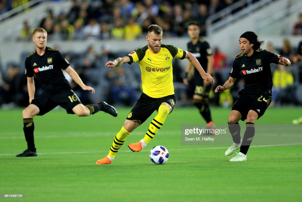 Calum Mallace #16 and Lee Nguyen #24 of Los Angeles FC defend against Andriy Yarmolenko #9 of Borussia Dortmund during the second half of an International friendly soccer match at Banc of California Stadium on May 22, 2018 in Los Angeles, California.