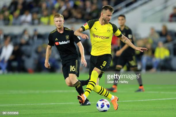 Calum Mallace of Los Angeles FC defends against Andriy Yarmolenko of Borussia Dortmund during the second half of an International friendly soccer...