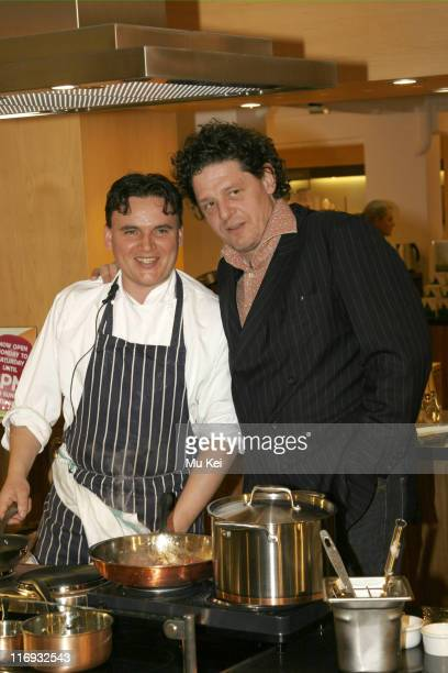 Calum Watson and Marco Pierre White during Marco Pierre White Launches The White Heat Cookery Collection at Harrods April 8 2006 at Harrods in London...