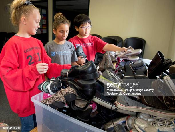 Calvary Christian School fourth graders sort donated shoes as part of the school's annual shoe drive to benefit Soles4Souls an international...