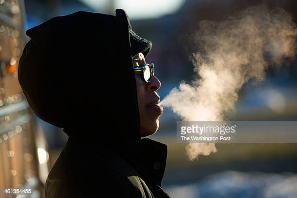 Calvert County bus driver Amber James takes a coffee break between bus routes in Dunkirk MD on November 7 2014 Temperatures dropped below zero...