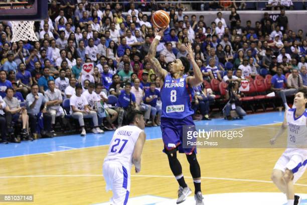Calvin Abueva of the Philippines soars over Jhen Huang from Chinese Taipei to convert an uncontested layup during their FIBA World Cup Qualifying...