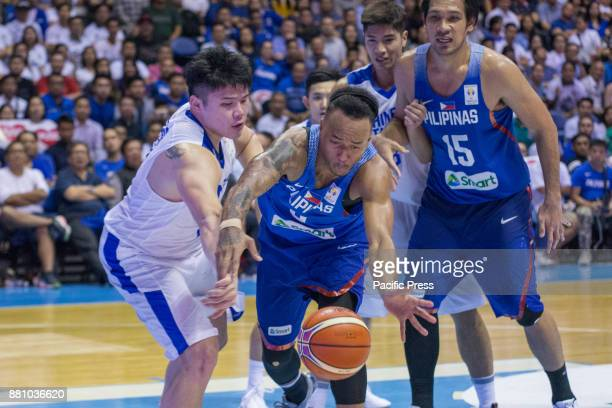 Calvin Abueva rushing to the ball against KuanChuan Chen Gilas Pilipinas defended their home against Chinese Taipei Game ended at 90 83